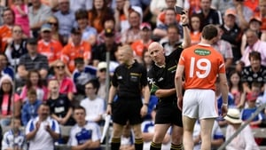 Armagh's Finnian Moriarty receives a black card late in the game in Clones