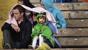 This young fan seems distinctly unimpressed with the rain in Clones