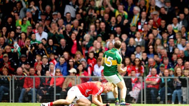 Kerry's James O'Donoghue celebrates a score at Páirc Úi Chaoimh as Michael Shields of Cork lies crestfallen