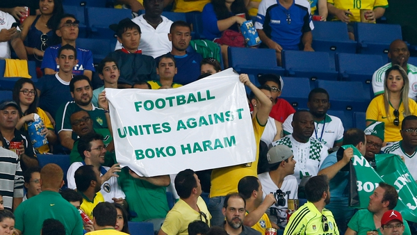 Fans protest against Boko Haram during the World Cup match between Nigeria and Bosnia-Herzegovina