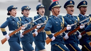 Members of an honour guard shout as they march during a welcoming ceremony for German Chancellor Angela Merkel outside the Great Hall of the People in Beijing, China