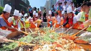 Volunteers join to make bibimbap, a traditional Korean dish made with vegetables, sliced beef, steamed rice and hot pepper sauce, at an event in Seoul, South Korea
