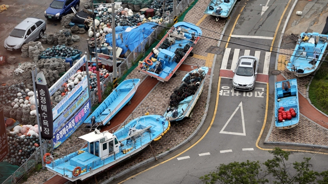 South Korean fishing boats take shelter ashore in Busan, as Typhoon Neoguri approaches