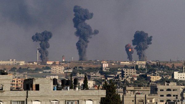 Smoke rises after an Israeli missile hit Gaza earlier today