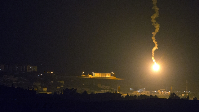 An Israeli flare lights up the Gazan coast