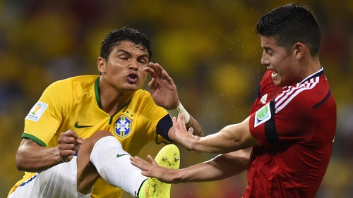 Brazil's captain Thiago Silva vies with Colombia's James Rodriguez