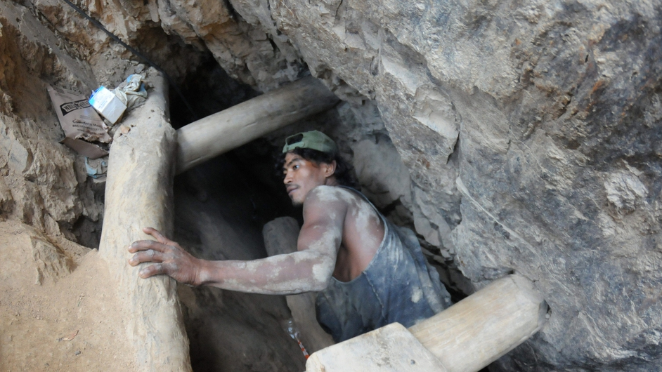 A miner takes part in a rescue operation for eight coworkers trapped underground in the locality of San Juan Arriba, Southern Honduras