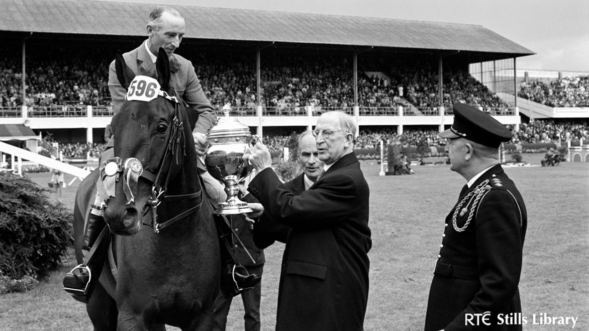 President Éamon de Valera presents a trophy to a champion rider. But who is he?