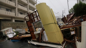 The remains of a restaurant lie on a street after it collapsed in Matsugawa district of Naha city