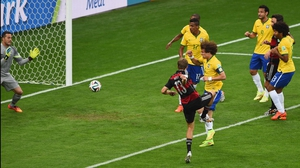 Yet, Germany struck first when forward Thomas Mueller scored on his side's first corner past Brazil defender David Luiz, who totally missed his mark on the play