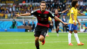 Miroslav Klose celebrates becoming the record goalscorer at World Cup finals with his 16th in four tournaments, this time against hosts Brazil