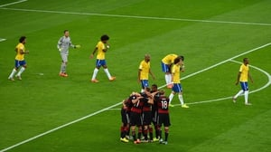 Germany huddled together to enjoy their sudden 5-0 lead over Brazil, who seemed dazed and shell-shocked at their historic meltdown