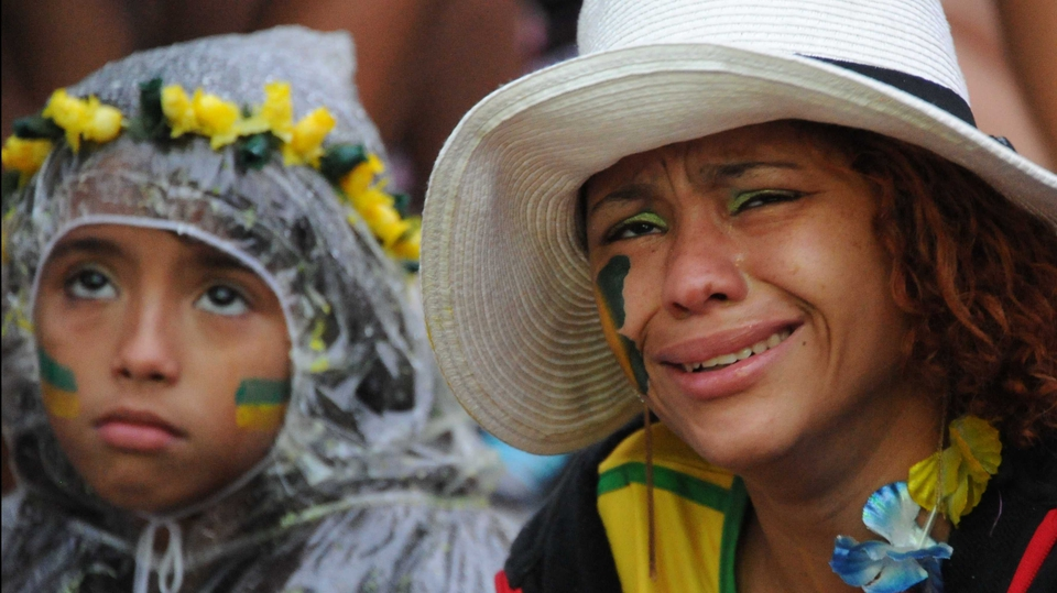 Brazil fans react to their remarkable 7-1 loss to Germany in the World Cup semi-final