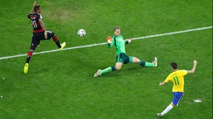 Brazil midfielder Oscar managed to score a consolation goal past Germany keeper Manuel Neuer at 90'
