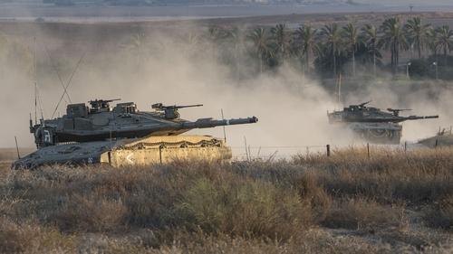 Israeli tanks at the southern Israeli border with Gaza following an Israeli air strike today