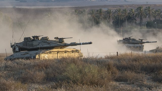 Israeli tanks at the southern Israeli border with Gaza following an Israeli air strike today