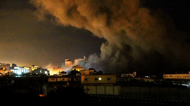 Smoke rises after an airstrike in the west of Gaza City