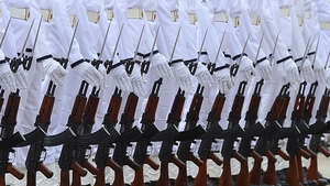 Sri Lankan navy personnel stand to attention in Colombo during a ceremony commissioning two Australian-gifted naval patrol boats to be deployed for preventing people smuggling