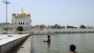 Sikh devotees take a holy dip in the 'Sarowar' or sacred pond of Gurdwara, Darbar Sahib at Tarn Taran, India