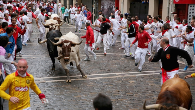 Bulls stampede through Pamplona's old town