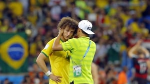 David Luiz is consoled by Brazil's suspended captain Thiago Silva after the 7-1 thumping by Germany
