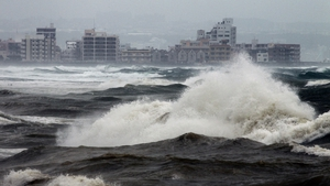 Huge waves generated by typhoon Neoguri hit Mizugama beach in Kadena, on the island of Okinawa