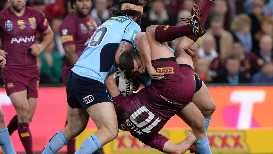 Nate Myles of the Maroons is picked up in the tackle by Greg Bird of the Blues during game three of the State of Origin series