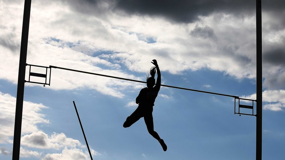 A competitor in the pole vault at the Cork City Sports event
