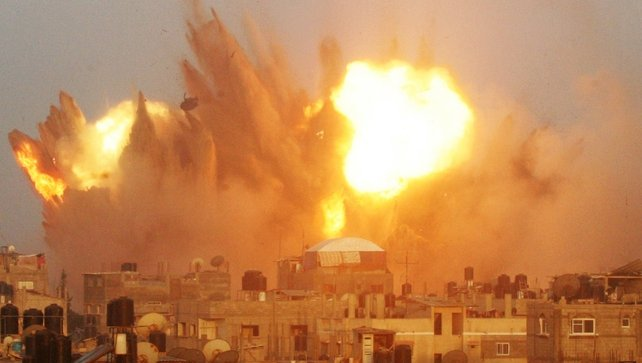 A ball of fire is seen following an early morning Israeli air strike on Rafah in southern Gaza