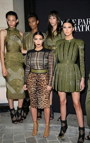 Kendall Jenner towered over older sister Kim Kardashian as they posed for pictures at Paris Fashion Week.