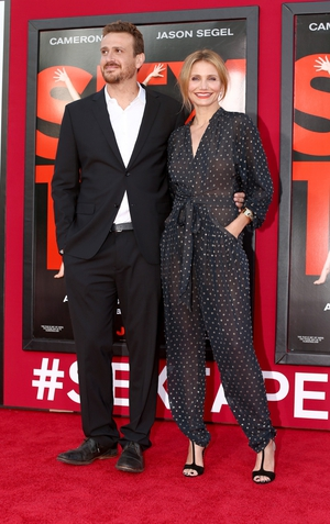 Jason Segel and Cameron Diaz smile for the cameras at the premiere of Sex Tape.