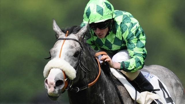 Ryan Moore riding The Grey Gatsby to victory at The Prix Du Jockey Club