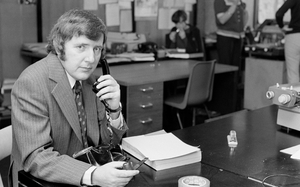 Pensive pipe-smoking in 1974: Bill on the sports desk