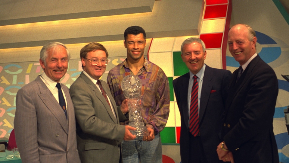 Paul McGrath receives an award after Italia '90