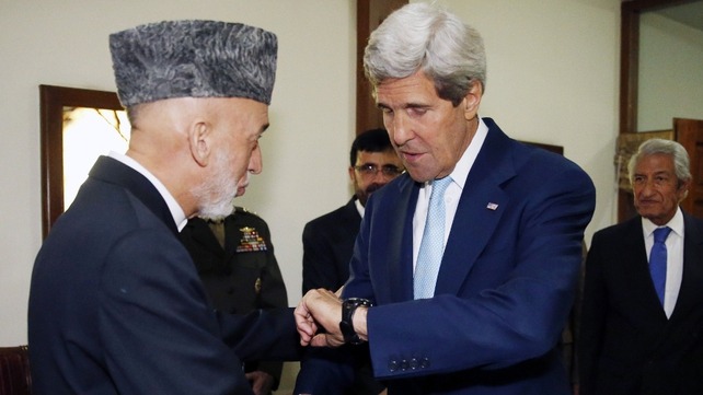 John Kerry met with Afghan President Hamid Karzai as part of negotiations