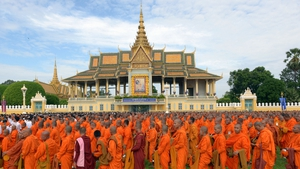 Cambodian Buddhist monks line up during a Buddhist ceremony in front of the Royal Palace in Phnom Penh
