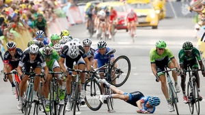 Rider takes a fall near finish line of the 7th stage of the 101st Tour de France cycling race