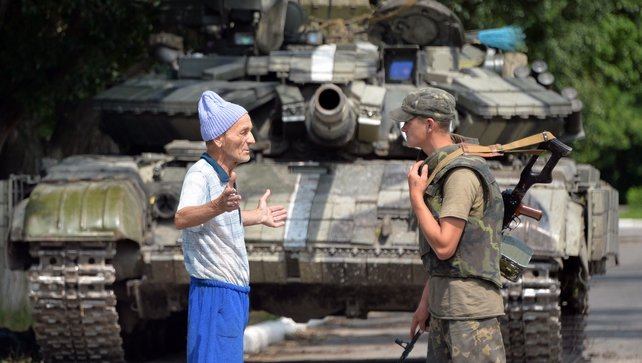 A local resident talks with a Ukrainian in Seversk, one day after the town was freed from pro-Russian militants