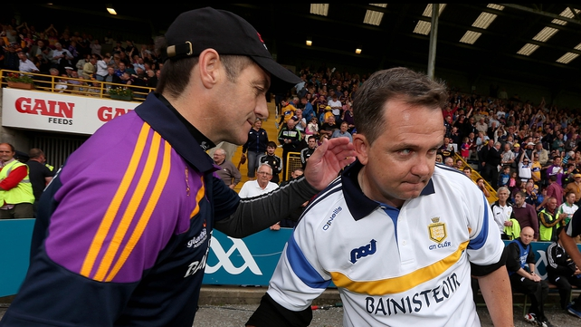 Wexford manager Liam Dunne commiserates with Davy Fitzgerald (R) after the game.
