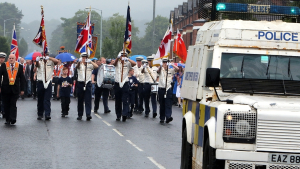 PSNI leads an Orange Order parade as it mounted a major, but low-key security operation