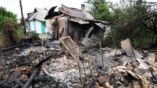 The shell landed in the garden of a house in a small town on the Russian called Donetsk