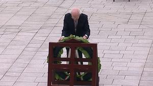 President Michael D Higgins lays a wreath