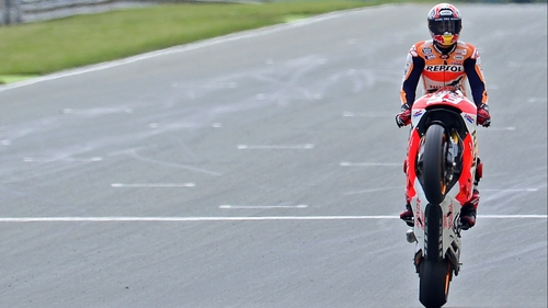 Marc Marquez pulls a wheelie to celebrate victory