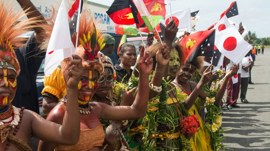 Papua New Guineans greet Japan's Prime Minister on a visit to their country