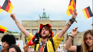 By the next afternoon, fans all over the world were up and cheering, from Berlin...