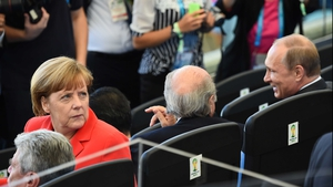 Germany's chancellor Angela Merkel looked a bit left out, sitting next to FIFA president Sepp Blatter and Russian President Vladimir Putin - who acted like regular ole chums