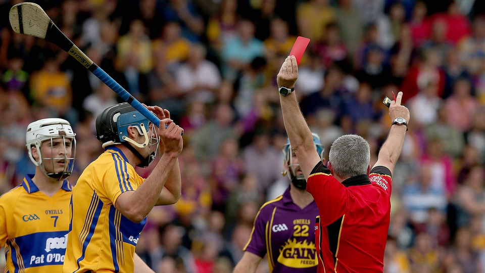 Clare's Brendan Bugler is shown a straight red card by referee Johnny Ryan