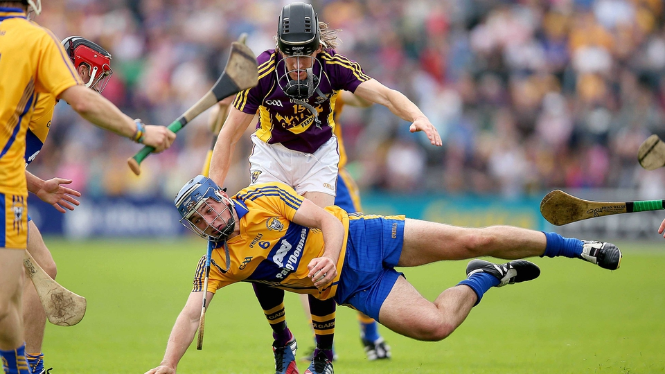 Wexford's Liam Og McGovern with Conor Ryan of Clare