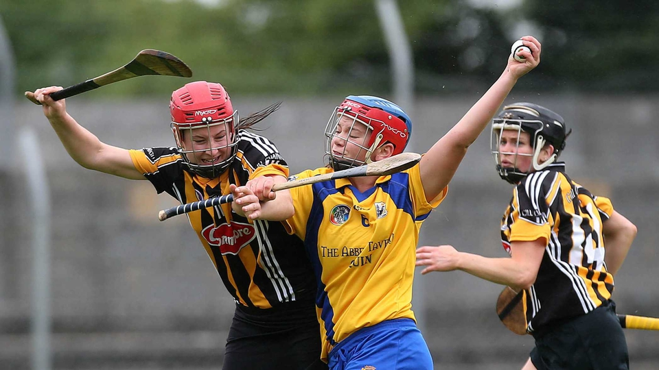 Clare's Niamh O'Dea and Aisling Dunphy of Kilkenny battle in the camogie championship