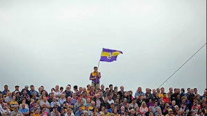 Meanwhile, a lone Wexford fan flies his county colours on the terrace